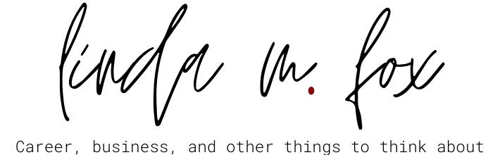 linda m fox logo in black and red